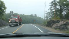 Curvy road. Approaching dump truck. Overcast, misty morning. Stock Footage