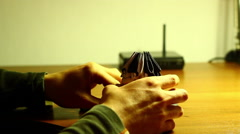 Young Guy Folding  3D Origami Stock Footage