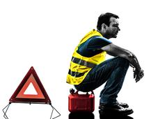 man accident yellow vest warning triangle silhouette - stock photo