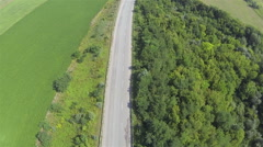 highway with cars and green fields. Aerial shot  top view Stock Footage