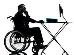 Handicapped business man working in wheelchair silhouette in wheelchair silho Stock Photos