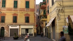 Europe Italy Liguria region city of Albenga 027 old woman sits on a piazza Stock Footage