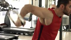 Muscular Man Workout On Pulley Deltoids Raise Stock Footage