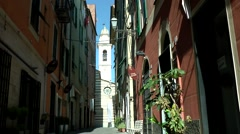Europe Italy Liguria region city of Albenga 024 colorful alley with church tower Stock Footage