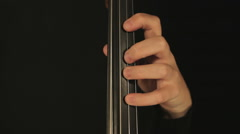 Gentle movements of the bow while fingering on fingerboard strings of a Cello - stock footage