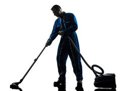 man janitor vaccum cleaner cleaning silhouette - stock photo