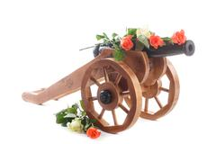 Vintage decorative wooden mortar with blooming roses Stock Photos