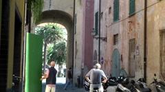 Europe Italy Liguria region city of Albenga 025 street life at the town gate Stock Footage