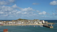 Stock Video Footage of St Ives harbour beach timelapse fast moving clouds, Cornwall England.