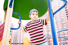 Young boy in bandana on playground Stock Photos