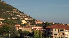 Europe Italy Liguria Pietra Ligure 003 sunset opposite the houses at hillside Stock Footage