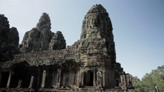 Wide shot of the Bayon temple in Angkor, Cambodia Stock Footage