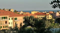 Europe Italy Liguria Pietra Ligure city 004 pastel colored houses during sunset Stock Footage