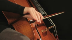 Cellist Playing Cello, side view Stock Footage