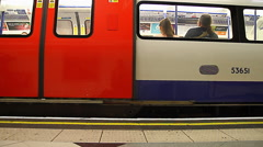 Underground train leaving platform in london Stock Footage