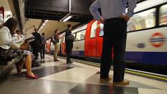 Commuters underground train coming into platform Stock Footage