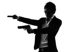 Asian gunman killer  portrait shooting silhouette Stock Photos