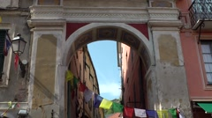 Europe Italy Liguria region Finalborgo village 006 old archway with flags Stock Footage