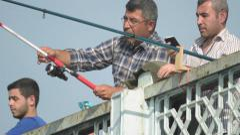 Turkish people fishing on the Galata Bridge (Editorial) - stock footage