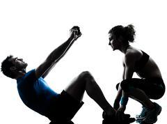 Man woman exercising abdominal workout fitness silhouette Stock Photos