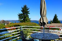 walkout deck with patio area overlooking scenic bay view in federal way, wa - stock photo