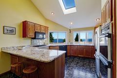 beautiful kitchen room with skylight granite tile floor - stock photo