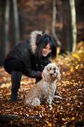 girl and cocker spaniel - stock photo