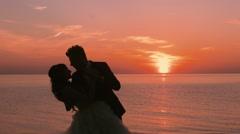 Wedding kiss loving couple at sunset Stock Footage