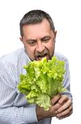 Man holding lettuce isolated on white Kuvituskuvat