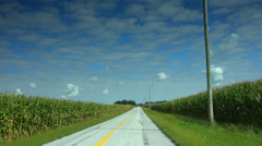 Driving thru corn belt on back road Stock Footage