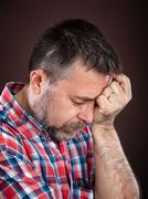 elderly man suffering from a headache - stock photo