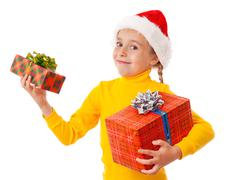 smiling girl in santa hat with two gift boxes - stock photo