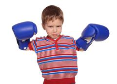 anger little boy with boxing gloves, isolated on white - stock photo