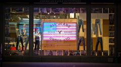 Window Dressing Clothing Display Denim Jeans Broadway Manhattan Flag NYC Night Stock Footage