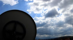 Clouds Moving Time Lapse Satellite Dish in the Foreground Stock Footage