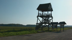 Birdwatching tower next to meadow Stock Footage