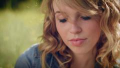 Closeup Of Beautiful Young Woman Enjoying Nature, She Smiles Wide - stock footage