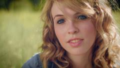 Closeup Of Young Contemplative Woman, She Looks Down, Then Up At Camera - stock footage
