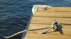 Cleat on wooden dock. - stock footage