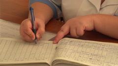 Nurse fills medical cards, Nikolaev, Ukraine Stock Footage