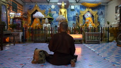 Buddhist Devotee Praying in Front of Temple Shrine in Yangon, Myanmar Stock Footage