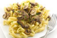 Pasta dish gigli con funghi Stock Photos