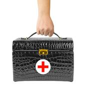 First aid bag in hand Kuvituskuvat
