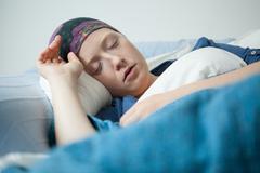 young woman having tumor sleeping - stock photo