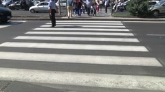 Zebra, pedestrians cross passing road.00000 - stock footage