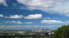 Los Angeles cityscape with clouds moving over blue sky Stock Footage