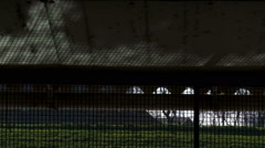 Caustic reflection from water on dirty ceiling through fencing in Dutch cowshed - stock footage