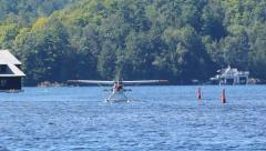 Seaplane taxiing on the lake. Stock Footage