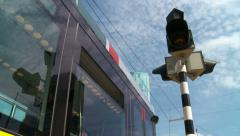 Low angle tripod shot of tram passing. Renewable energy in green city Stock Footage