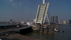 Open bridge for passing boat, Erasmusbrug in Rotterdam, The Netherlands Stock Footage